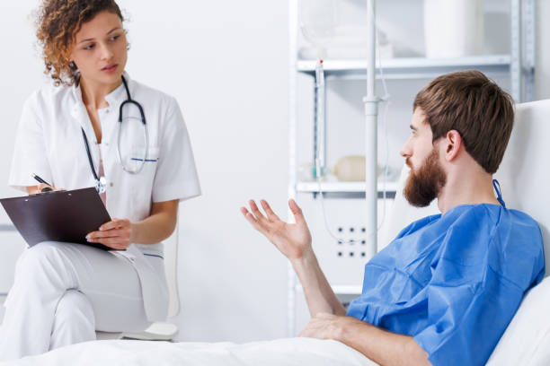trauma patient talking with nurse - psychiatric ward stock photos and pictures