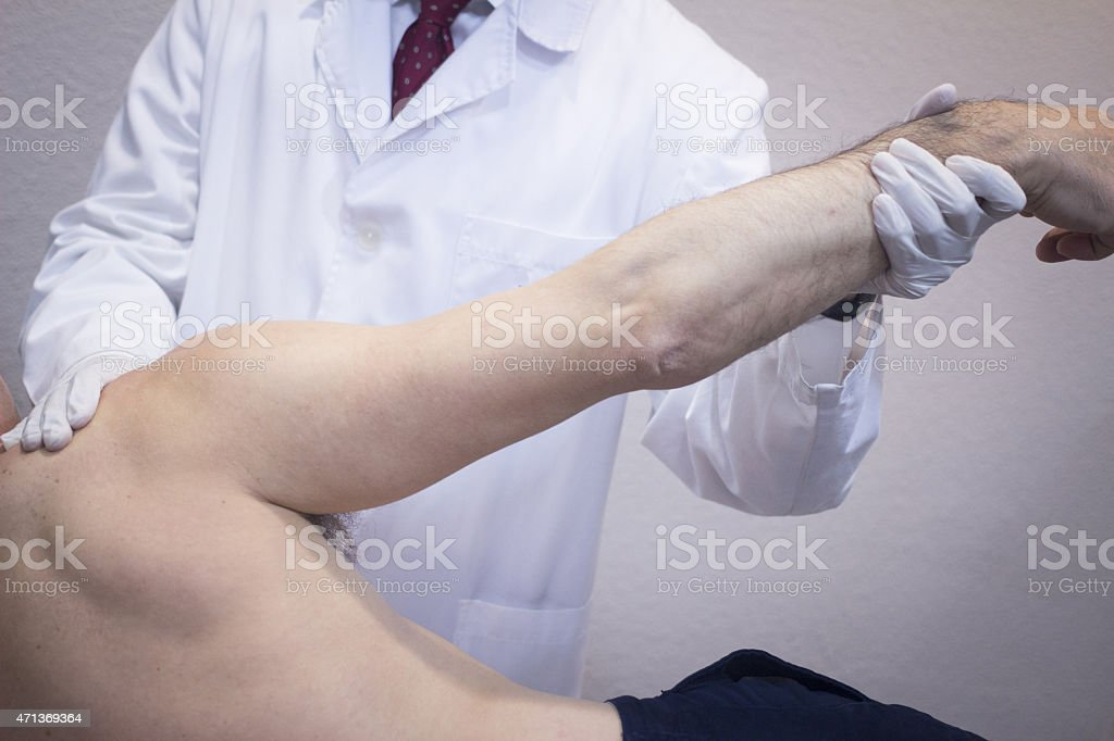 Traumatologist orthopedic surgeon doctor examining patient stock photo
