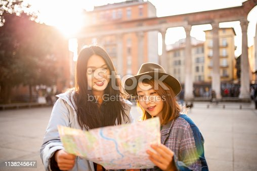 Two smiling Asian girls visiting Italy.