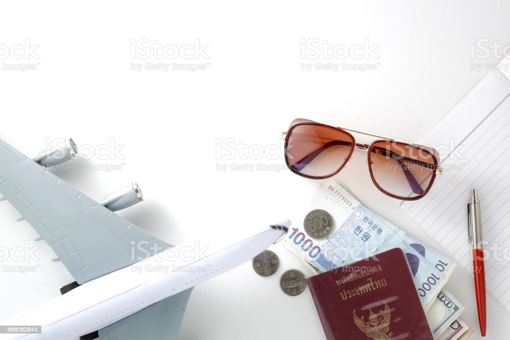 Travel accessories necessary for the holidays passport banknote hat sun glasses camera cap book on a white background stock photo