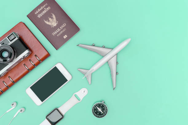 travel accessories objects and gadgets top view flatlay on blue pastel - phone, travelling, copy space imagens e fotografias de stock