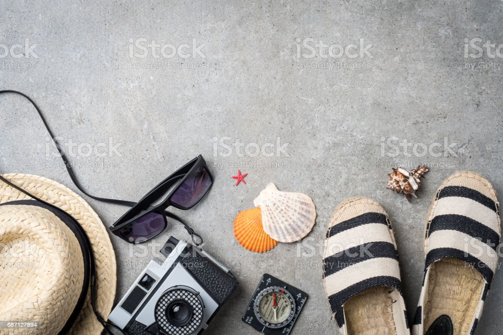 Travel accessories on gray stone background stock photo