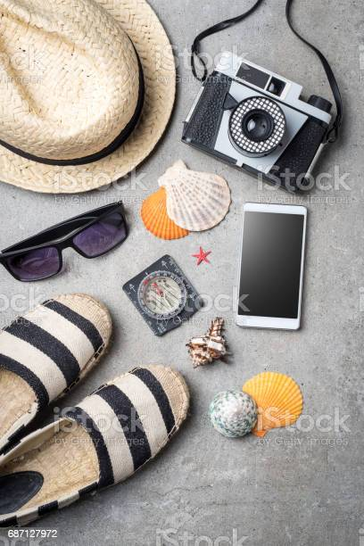 Travel accessories on gray stone background picture id687127972?b=1&k=6&m=687127972&s=612x612&h=d sowb m6doiqd3ogugi0fp 2o8qvgxzzoyabdkhu8m=