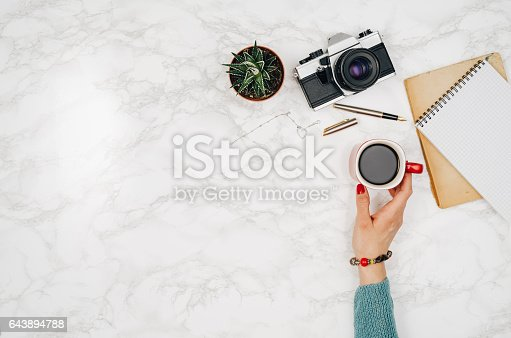 istock Travel accessories top view on white marble table background 643894788