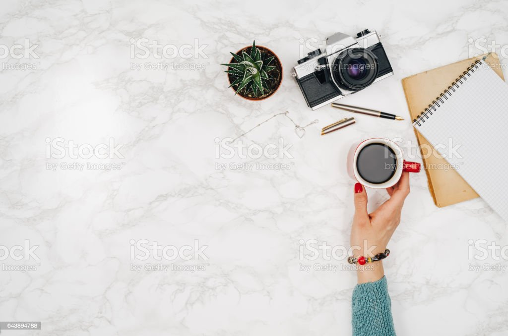 Travel accessories top view on white marble table background stock photo