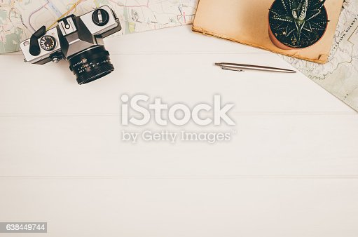 istock Travel accessories top view on wooden background with copy space 638449744