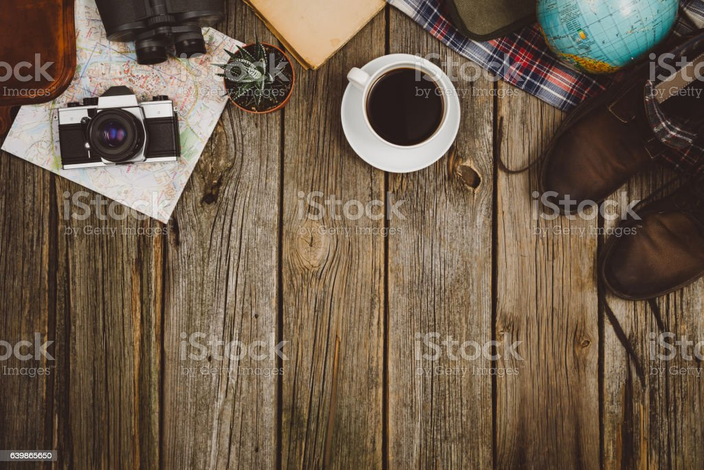 Travel accessories top view on wooden background with copy space stock photo