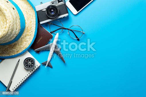 istock Travel accessories with copy space on blue background 658538120