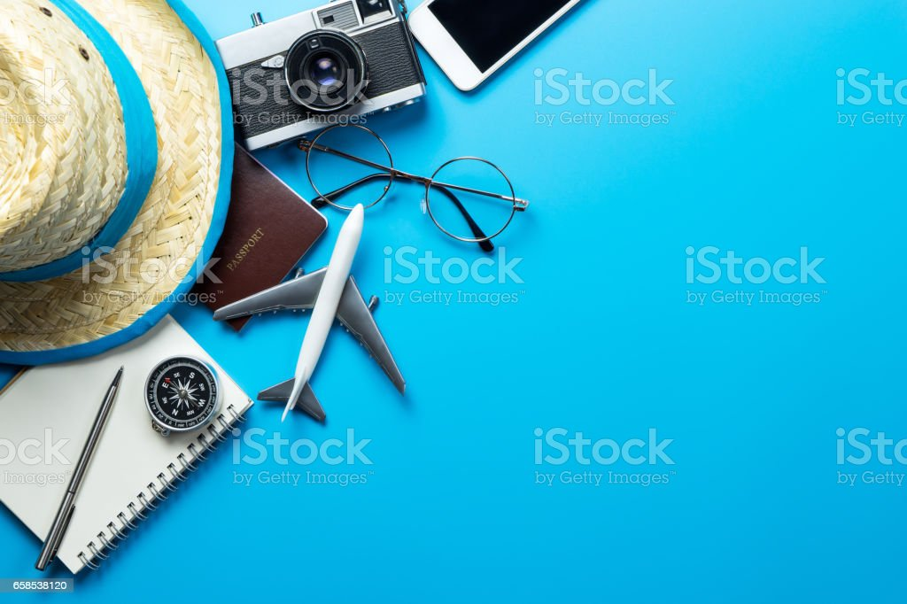 Travel accessories with copy space on blue background stock photo