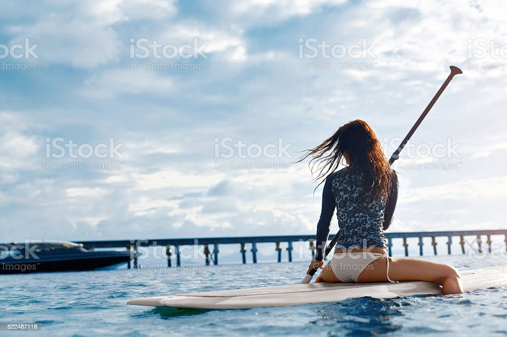 Travel Adventure. Beautiful Fit Woman Paddling On Board In Sea At...