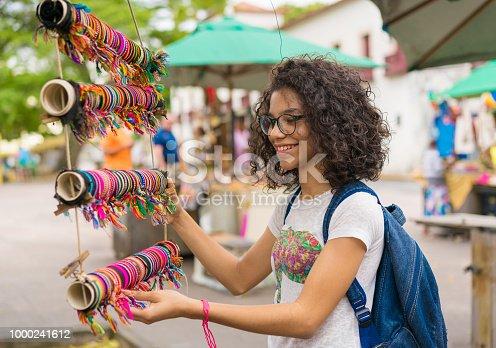 Teenage girl buying handicrafts at the handicraft fair in Olinda, Pernambuco, Brazil