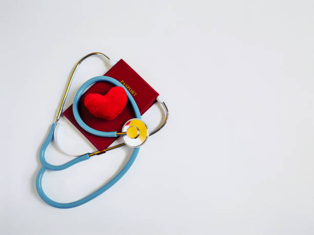 Travel and Healthcare Concept Stethoscope, passport and heart shaped in white background. Stock photo. pasport malaysia stock pictures, royalty-free photos & images