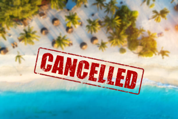 Travel and holidays cancelled due to epidemic of coronavirus. Tourism and resort cancelation due to Covid-19. Aerial view of beautiful tropical sandy beach, palm trees, blue sea in summer and text stock photo