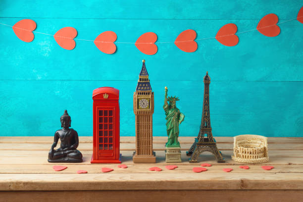 travel and tourism background with souvenirs from around the world. - souvenir foto e immagini stock