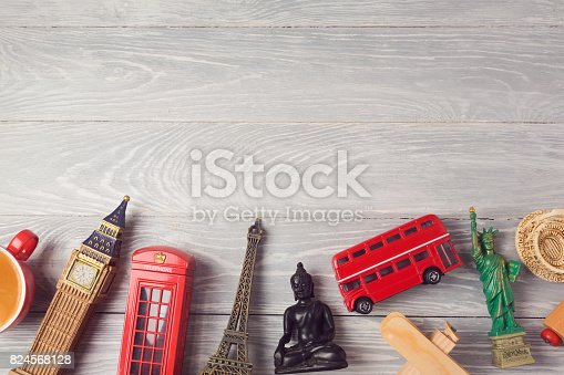 Travel and tourism background with souvenirs from around the world. View from above. Flat lay