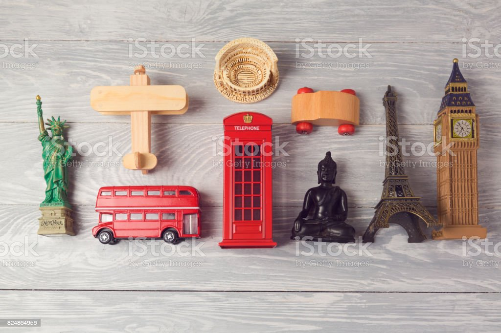 Travel and tourism background with souvenirs from around the world. View from above. Flat lay stock photo