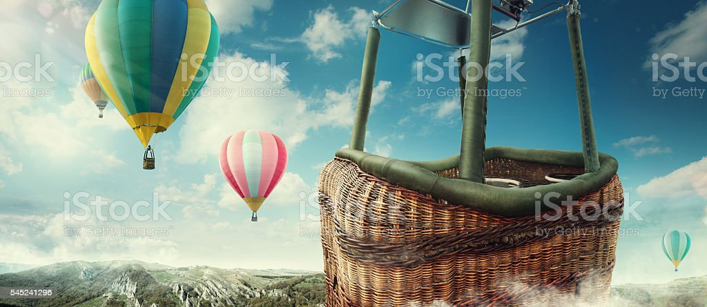 Travel and Tourism. Colorful hot-air balloons flying over the mountain. stock photo