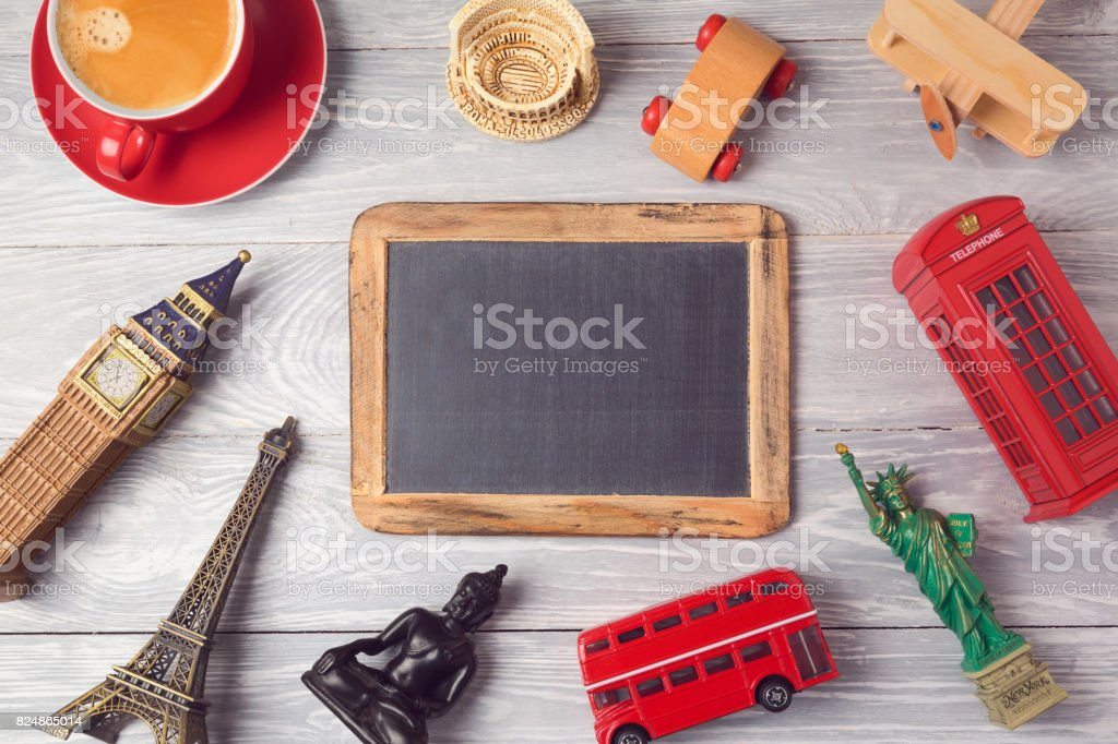 Travel and tourism concept with chalkboard and souvenirs from around the world. View from above. Flat lay stock photo
