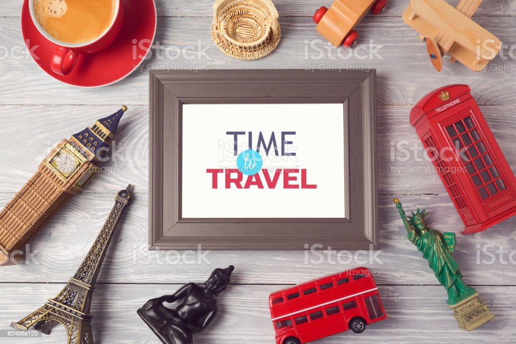 Travel and tourism concept with photo frame and souvenirs from around the world. View from above. Flat lay stock photo