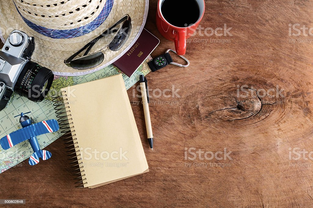 Travel and vacation accessories on wooden background stock photo