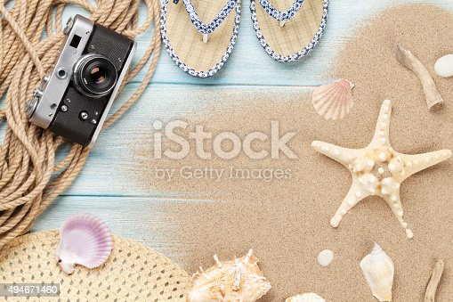 699960484 istock photo Travel and vacation items on wooden table 494671460