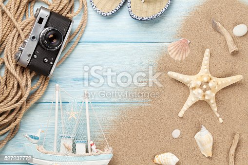 699960484 istock photo Travel and vacation items on wooden table 527237772
