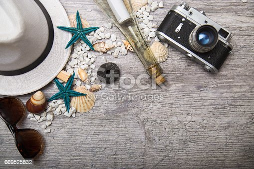 699960484istockphoto Travel and vacation items on wooden table 669525832