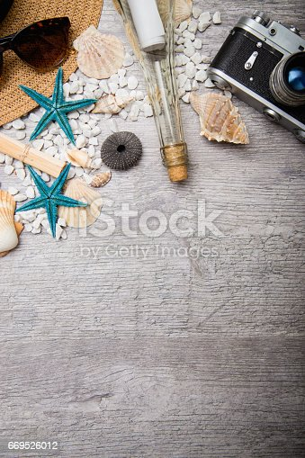 699960484istockphoto Travel and vacation items on wooden table 669526012