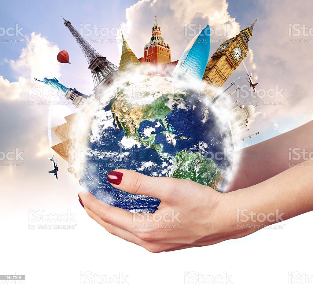 Travel around world with famous landmarks on globe in hands stock photo