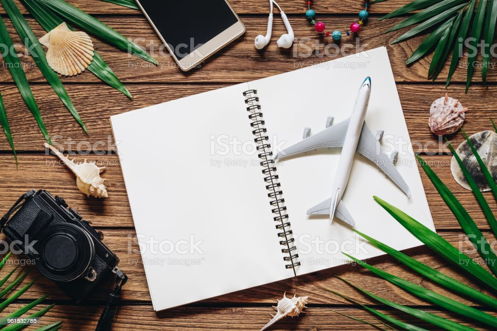 Travel Background concept. Open notebook with blank space for your text. Flat lay top view with copy space. stock photo