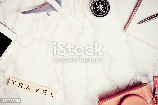 istock Travel blogger writer accessories on luxury white marble table with copy space in middle 654722296