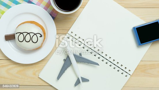 istock Travel blogger writing book in cafe table pastel tone. 546432826
