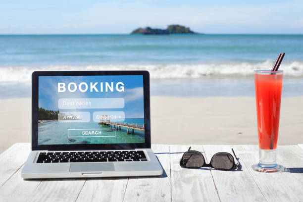 travel booking, hotels and flights reservation on internet travel booking, hotels and flights reservation on the screen of computer dealing cards stock pictures, royalty-free photos & images