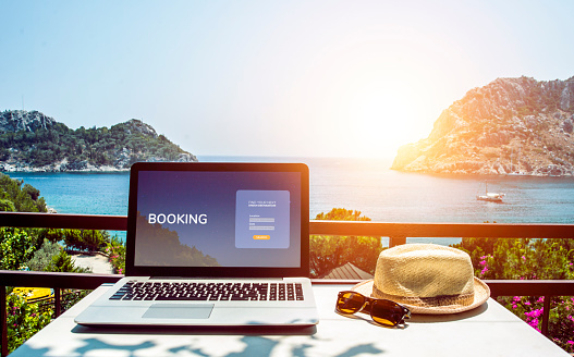 Travel booking web page concept. Booking on the internet. Laptop mock-up with sea view
