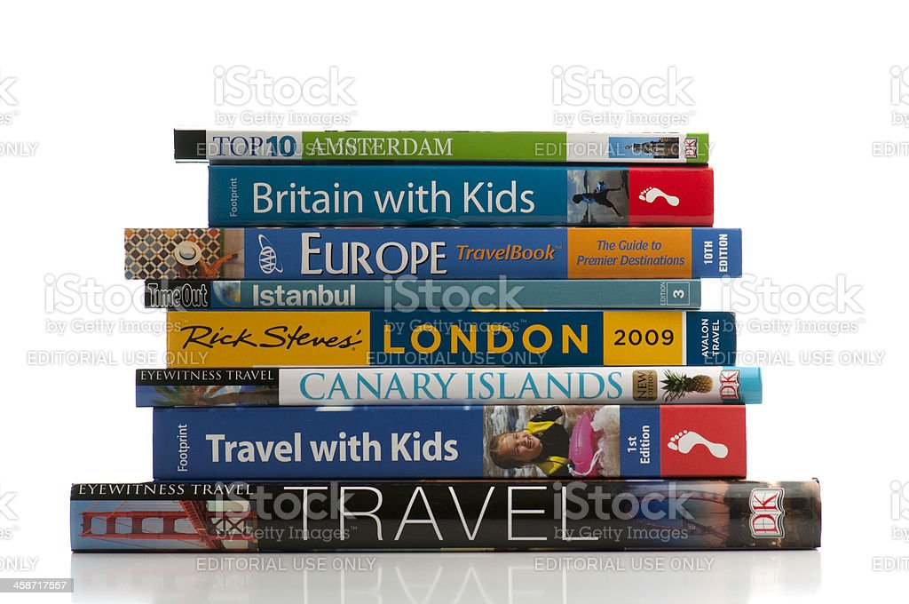 Travel books stacked in front of white background royalty-free stock photo