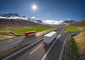 istock Travel bus and truck on the asphalt road in beautiful landscape at sunny day 1270754165