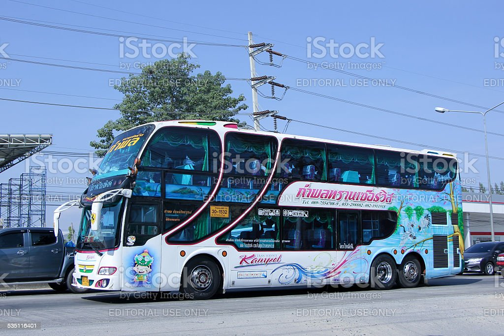 Travel bus of Kampol Tran Service Transport. Photo at road no 1001...