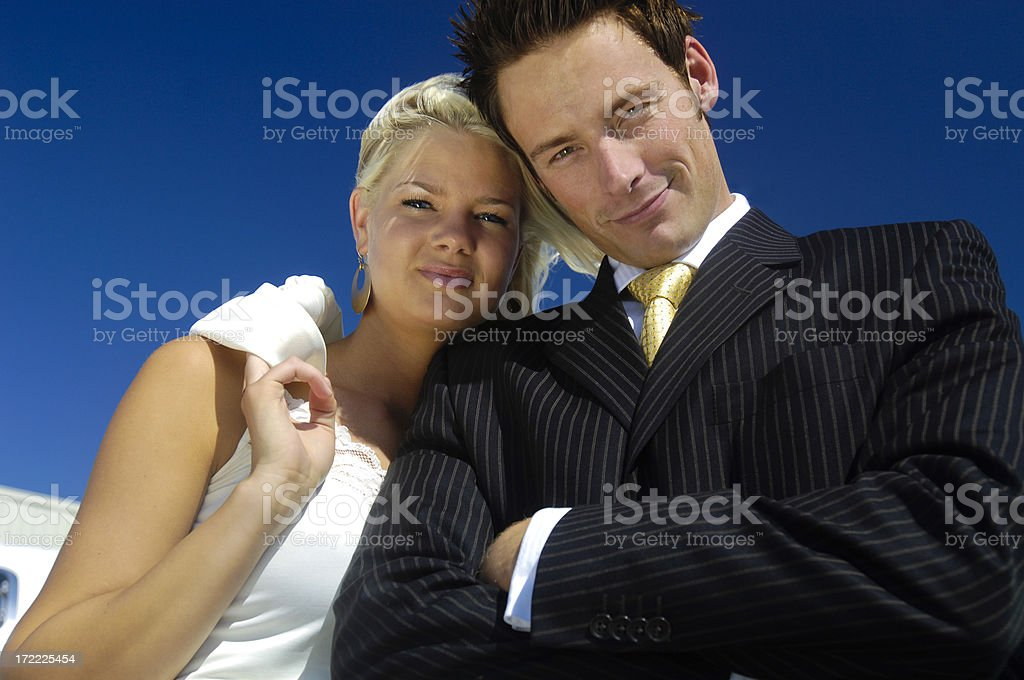 Travel - Businessman and woman next to private jet royalty-free stock photo