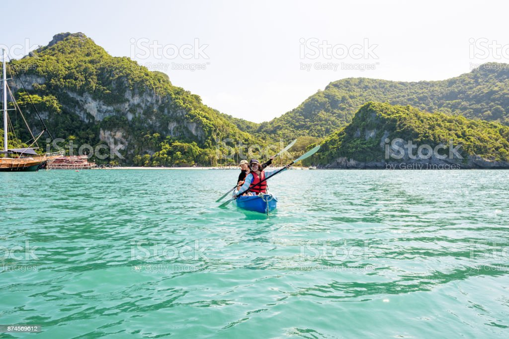 Travel by boat with a kayak stock photo
