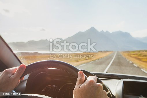 istock travel by car, road trip adventure, hands od driver on steering wheel 1154923251