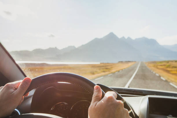 travel by car, road trip adventure, hands od driver on steering wheel - car view imagens e fotografias de stock