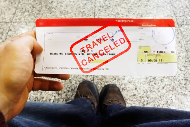 Travel canceled red stamp on boarding pass ticket stock photo
