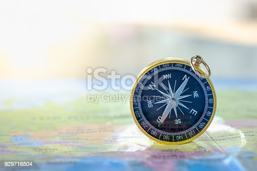 istock Travel Concept. Close up of compass on world map. 929716504