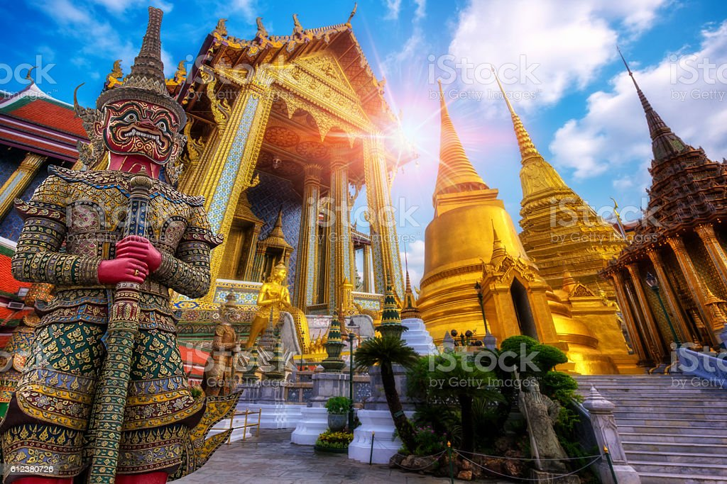 Travel concept, Giant statue at Temple Wat Pra Kaew stock photo