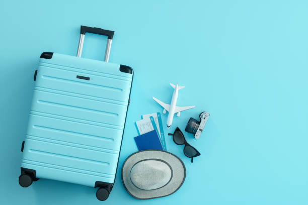 Travel Concept on Blue Background Travel Concept on Blue Background luggage stock pictures, royalty-free photos & images