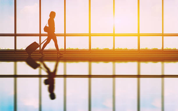 Travel concept people in the airports silhouette of young girl with picture id960185842?b=1&k=6&m=960185842&s=612x612&w=0&h=vfyazrjxba7xn4xslw00drbjpljm1k s4f04bpiys6q=
