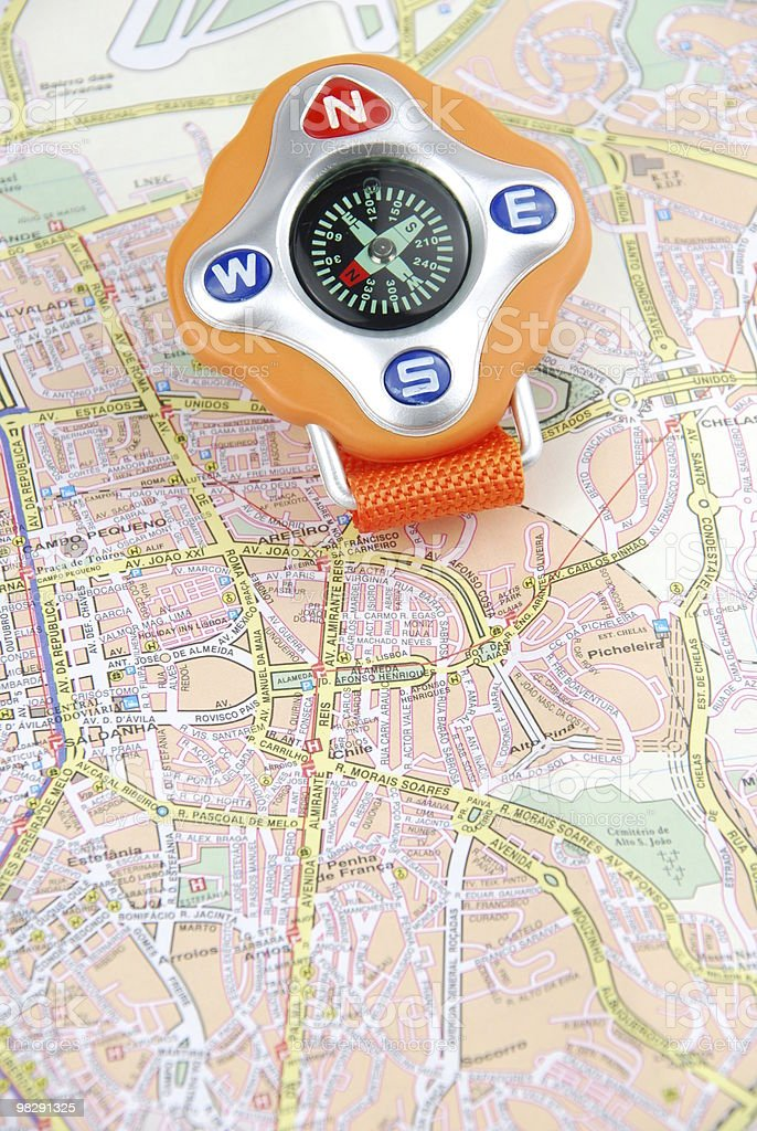 Travel concept with a compass on map royalty-free stock photo