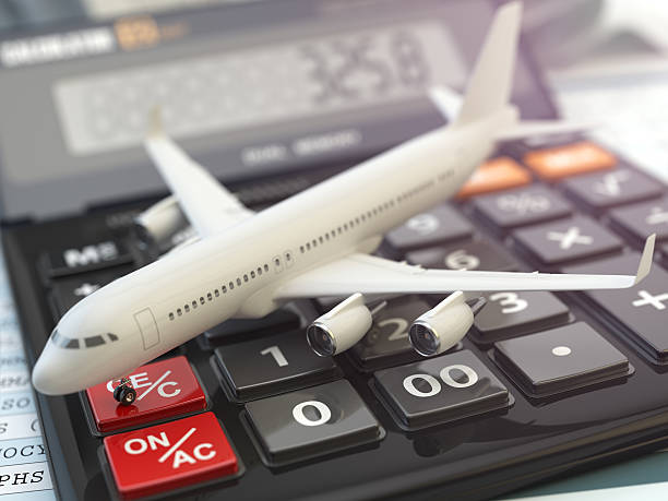 Travel cost calculation concept. Airplane and calculator. Cheape stock photo