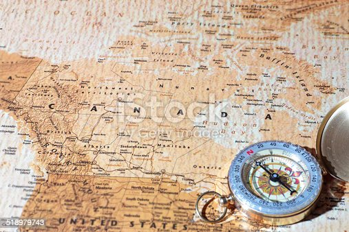 istock Travel destination Canada, ancient map with vintage compass 518979743