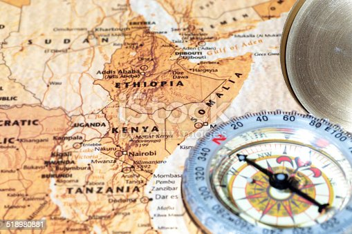 istock Travel destination Kenya, Ethiopia, Somalia: ancient map with vintage compass 518980881